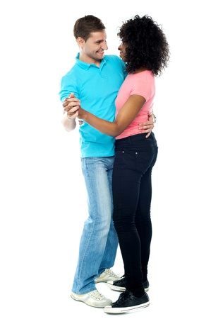 Full length portrait of adorable dancing couple enjoying themselves and getting romantic photo