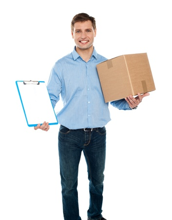kindly: Kindly accept the delivery. Courier services. Man holding clipboard and carton Stock Photo