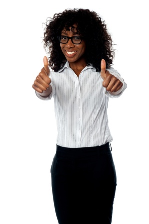 Successful african corporate woman gesturing double thumbs up photo