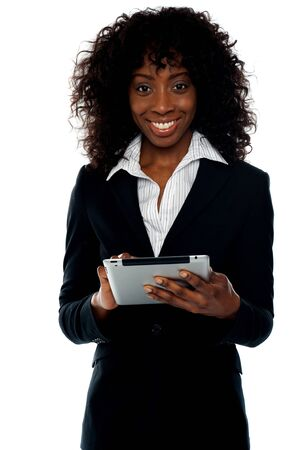 Young businesswoman using wireless tablet pc. Surfing internet photo