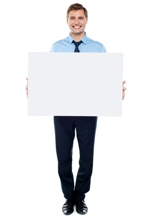 Businessman holding blank white billboard, full length portrait photo