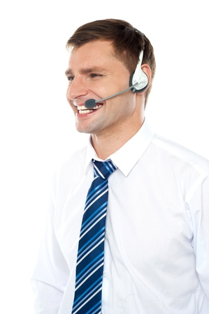 Customer support executive assisting clients wearing headset and looking away Stock Photo - 14435421