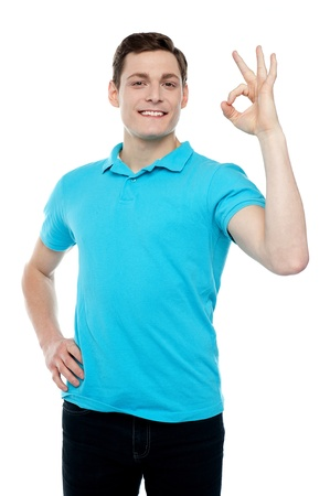 Smiling cool guy with an excellent gesture isolated against white background Stock Photo - 14517444