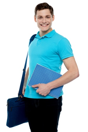 Smiling guy holding notepad and laptop bag smiling at camera Stock Photo - 14517438