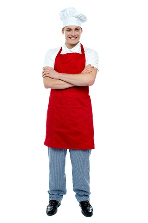 Handsome young cook posing in uniform with arms crossed, full length portrait Stock Photo - 14630383