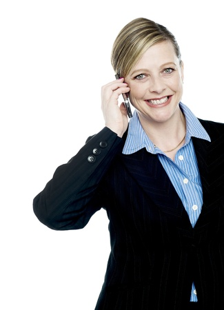Cropped image of a businesswoman communicating on cell phone isolated over white photo
