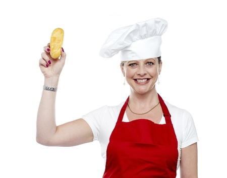 Female chef showing bread before baking it, time for hot dog Stock Photo - 14552868
