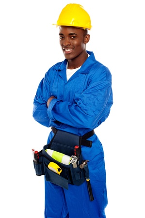 Smiling african worker posing with arms crossed isolated on white background photo