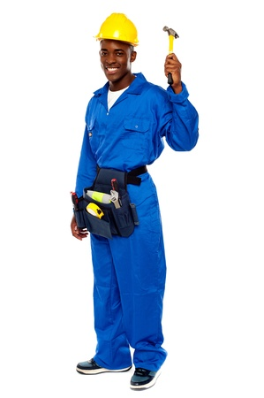 Young african repairman holding hammer isolated against white background photo