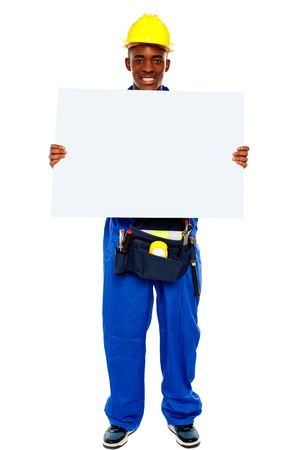 African contractor showing blank billboard, full length shot photo