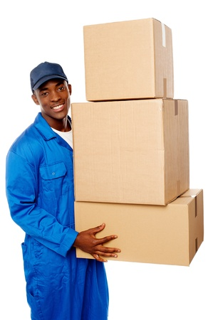 Young delivery guy holding stack of parcel boxes isolated against white photo