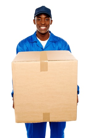Delivery guy holding big parcel and smiling isolated on white