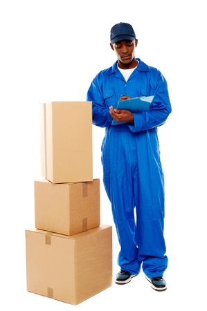 kindly: Delivery boy at work. Kindly accept your goods. All on white background Stock Photo