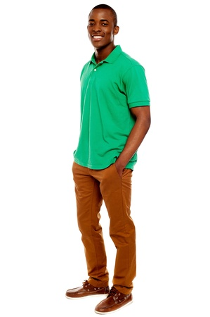 african people: Casual young guy posing with hands in pocket isolated on white background