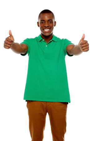 yup: Handsome african showing double thumbs up against white background Stock Photo