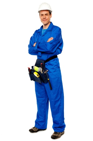 Industrial contractor posing with crossed arms isolated over white background Stock Photo - 14602757