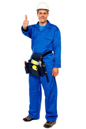 Worker with tools bag showing thumbs up standing against white background Stock Photo - 14603023