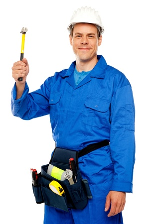 Male architect team guy holding hammer with tool box wrapped around his waist photo