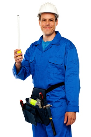 Building worker holding measuring tape isolated over white background photo