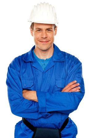 Isolated young attractive repairman posing with style photo