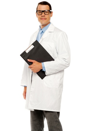 Doctor in glasses carrying clipboard on white background photo