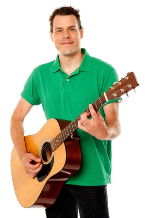 Smart rock guitar player at his best. Playing guitar against white background photo