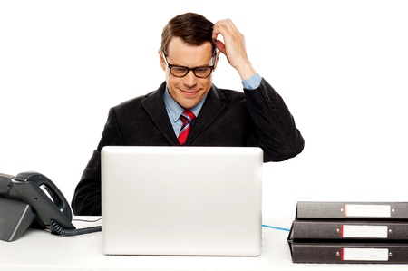 Confused male manager itching his head. Trying to understand business module photo