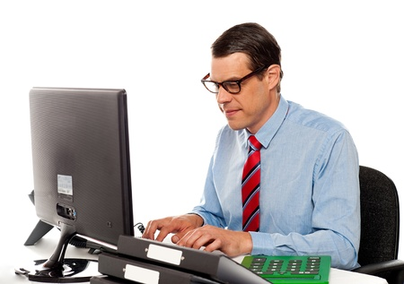 account executive: Portrait of an accountant working on computer in office Stock Photo