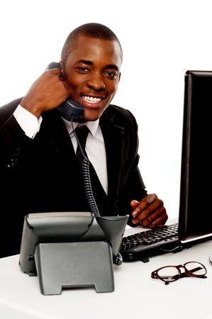 Cheerful young african talking on telephone against white background Stock Photo - 14603194