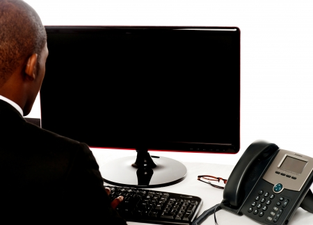 Cropped image of male executive working on pc isolated over white photo