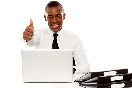yup: Happy young african gesturing thumbs up at camera Stock Photo