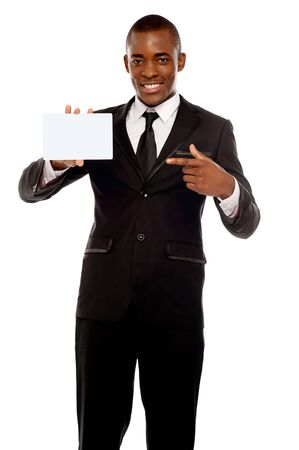 Business promoter pointing at blank placard looking right into camera photo