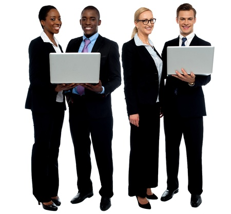 Two business teams posing with laptop over white background photo