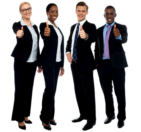 employees group: Full length portrait of successful corporate team gesturing thumbs up