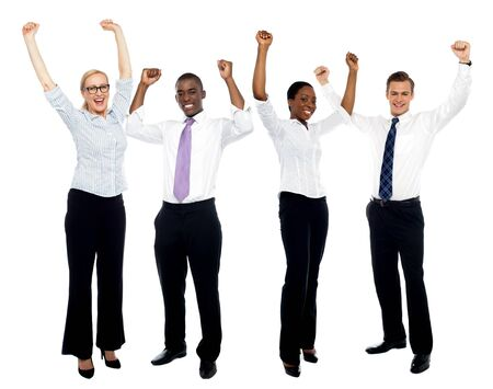 Full length portrait of happy successful business group over white background photo