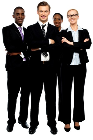 Group of business people, arms crossed. Full length portrait photo