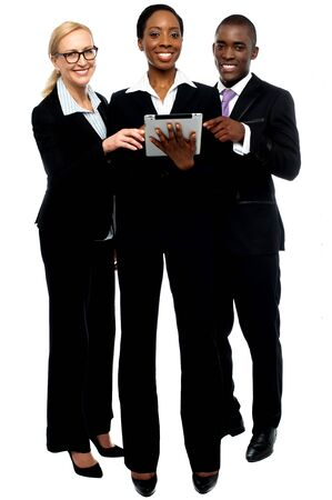 electronic devices: Technology savvy business team using tablet pc. Business concept