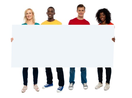 Confident young group showing blank poster, full length portrait photo