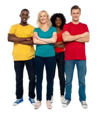 group of people: Team of young people standing with crossed hands against white background