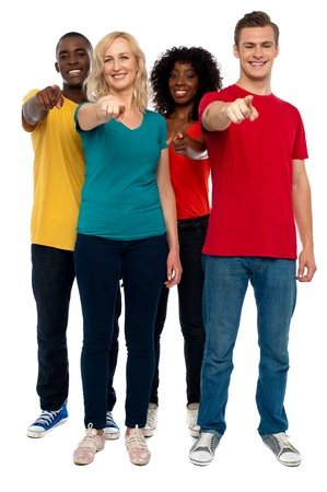 Cheerful group of teenagers pointing at you, full length shot Stock Photo - 14657545