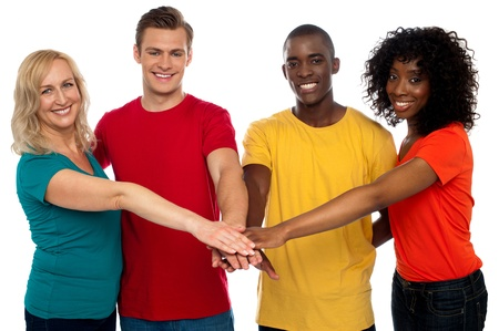 Friends standing with hand on hand looking at camera. Strong bonding Stock Photo - 14657576