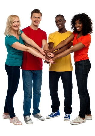 Group of young multicultural friends posing with hands on hands looking at you Stock Photo - 14657536