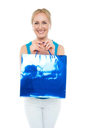 Happy aged woman carrying shopping bag looking at camera Stock Photo - 14724486