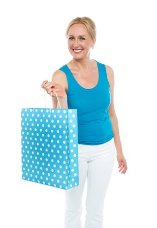 Shopping woman carrying bag, enjoying sale. All on white background Stock Photo - 14724642