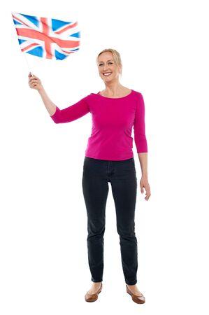 Full length portrait of aged patriotic lady waving United Kingdom flag Stock Photo - 14724388