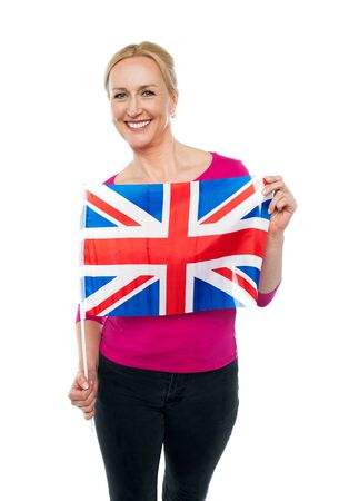 Cheerful female supporter holding national flag isolated against white background Stock Photo - 14724659