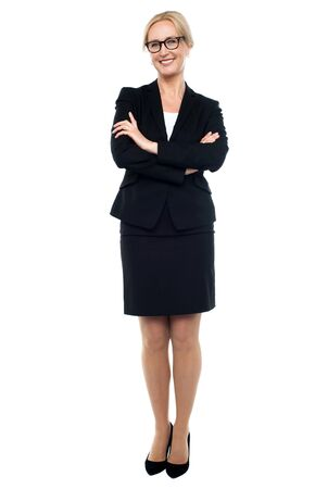 Full length shot of confident female manager posing with crossed arms Stock Photo - 14724387