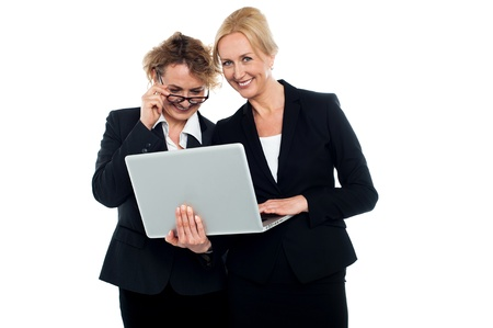 electronic devices: Business friends enjoying video on laptop and having great time Stock Photo