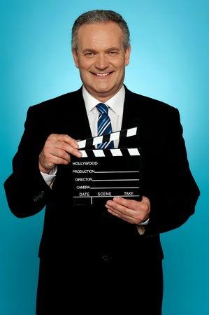 showtime: Its showtime. Businessman holding clapperboard