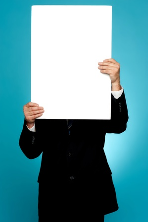 whiteboard: Manager hiding his face behind white banner ad isolated on gradient background